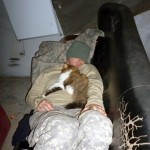 The Story Behind A Viral Photo of a Soldier Napping With a cat