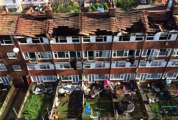 Aerial view showing damage to the apartment block