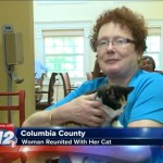 Woman is reunited with her beloved cat after fire