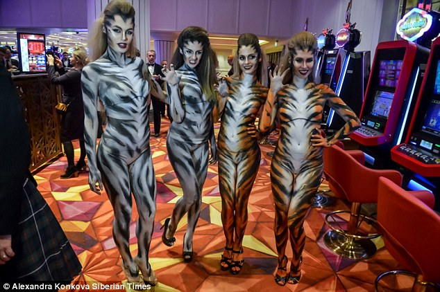 2E7D7B3C00000578-0-A_group_of_glamorous_women_in_tiger_costumes_performed_at_the_ca-a-16_1447669621056