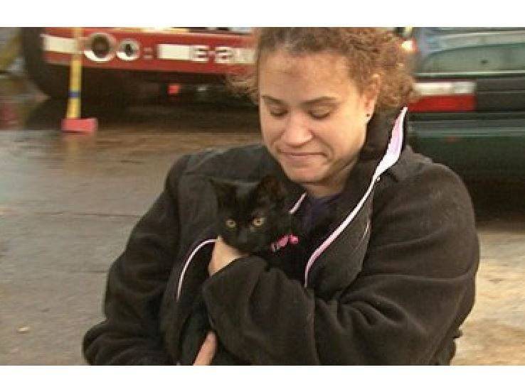 Woman is reunited with her cat at 4 alarm fire