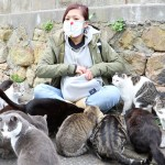 Girl Swarmed by Cats on Japan's Cat Island