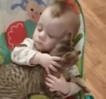 Baby Won't Let Go Of Cat